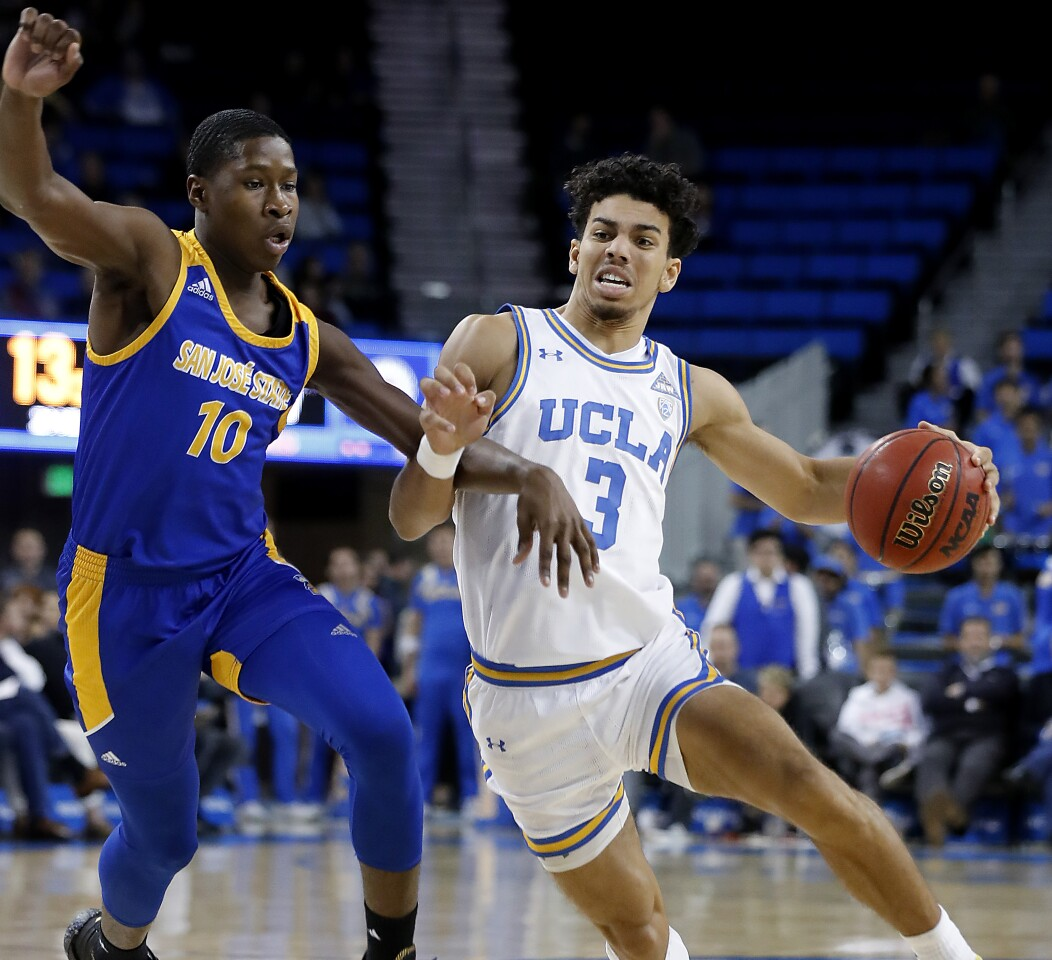 LOS ANGELES, CALIF. - DEC. 1, 2019. Bruins guard Jules Bernard drives down the key against San Jose State guard Omari Moore in the second half at Pauley Pavilion in Los Angeles on Sunday, Dec. 1, 2019. (Luis Sinco/Los Angeles Times)