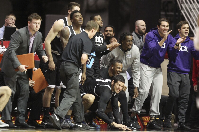 Grand Canyon's bench gets excited in the final minutes of the game against the Aztecs.