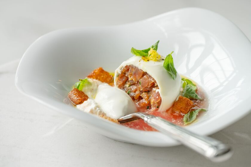 The deliciously creative tuna-stuffed burrata in tomato water at Il Dandy.
