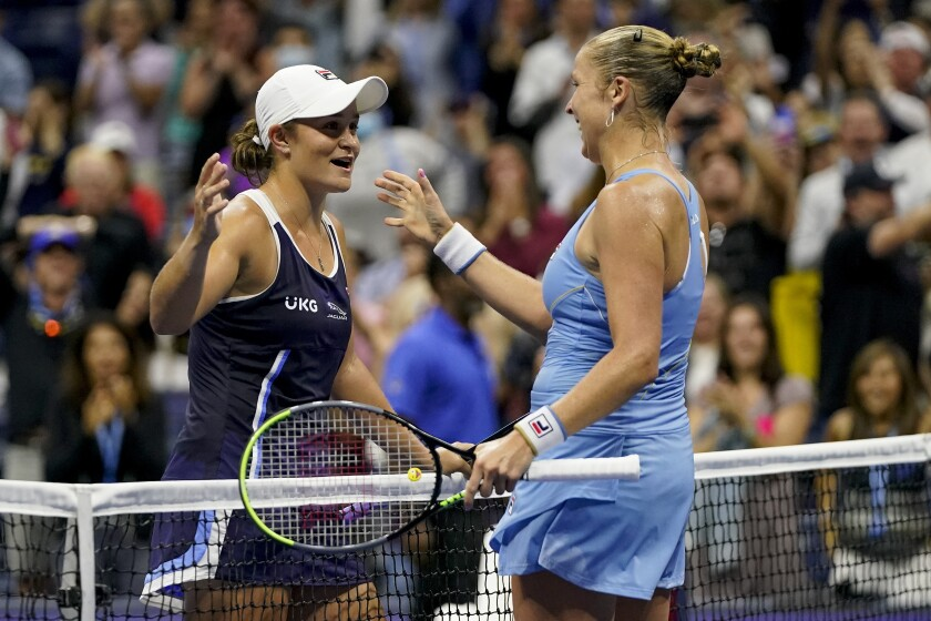Shelby Rogers greets Ashleigh Barty at the net after defeating her during the third round of the U.S. Open.