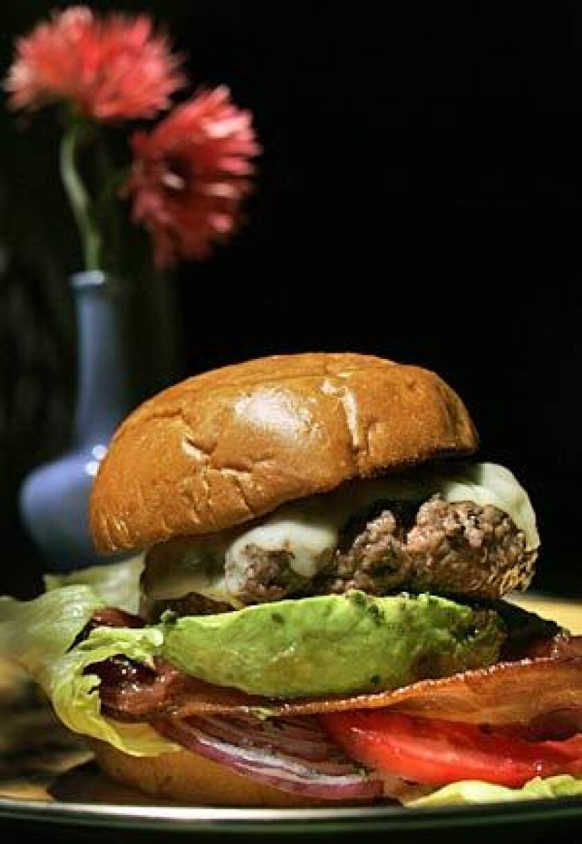 TOP THIS: The hamburger according to Silverton stars fat-enriched, coarse-ground prime chuck that's seasoned generously and handled gently.