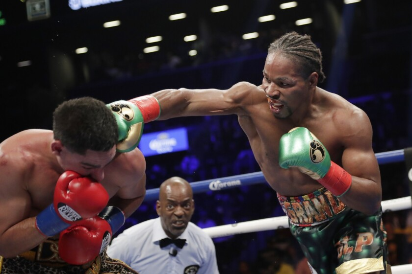 Shawn Porter, right, punches Danny Garcia.