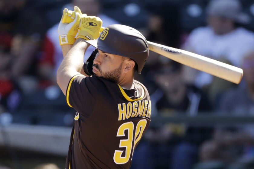 San Diego Padres' Eric Hosmer hits during the first inning of a spring training baseball game against the Kansas City Royals on Monday, Feb. 24, 2020, in Surprise, Ariz.