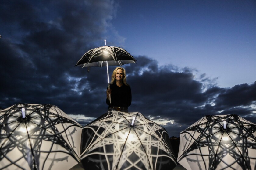 Light-up umbrellas will culminate in a night performance on a Southern California beach by artist Elizabeth Turk.