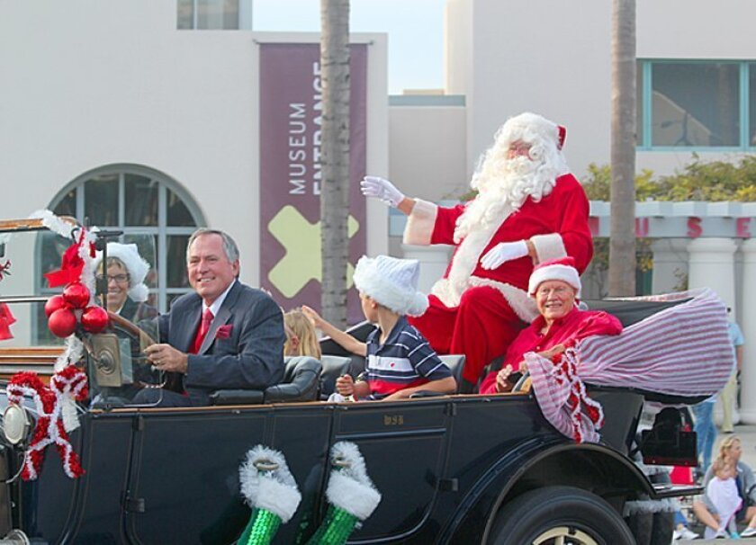 Santa Claus rides down La Jolla's Prospect Street in the Old Black Goose in 2014.