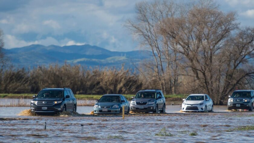 A flooded Interstate 5 snarled traffic for miles on Saturday in Northern California.