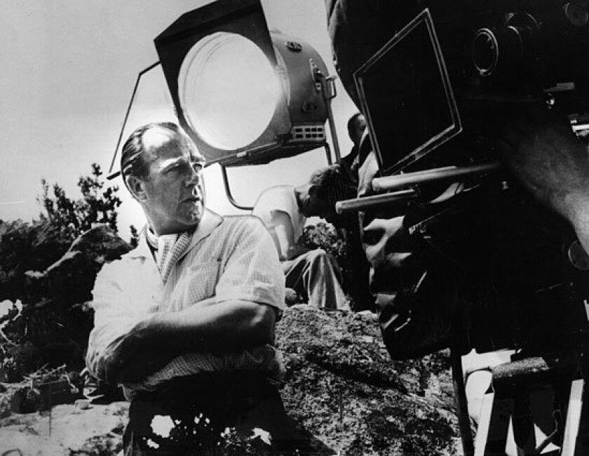 "Director Ronald Neame shooting 1957's ""Windom's Way."""