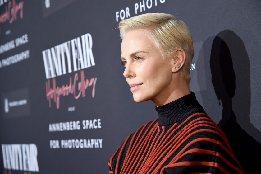 """Oscar nominee Charlize Theron at the opening-night party for """"Vanity Fair: Hollywood Calling."""""""