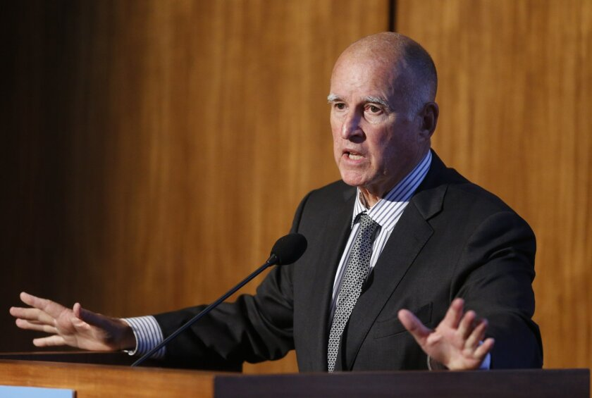 FILE - In this Oct. 27, 2015 file photo, California Gov. Jerry Brown speaks at the Carbon Neutrality Initiative on the campus of the University of California-San Diego, in San Diego. California lawmakers moved closer to extending the state's ambitious climate change law Tuesday, Aug. 23, 2016, after winning critical approval from business-minded Democratic lawmakers in the state Assembly with encouragement from the White House. Extending California's greenhouse-gas reduction plan is critical to the legacy of Brown, who has put climate change at the forefront of his priorities and touted the state's moves at the Vatican, at a climate summit in Paris and at the Democratic National Convention this summer. (AP Photo/Lenny Ignelzi, File)