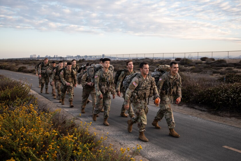 The Army ROTC Ranger Challenge team on Saturday participate in a 13-mile ruck march along Silver Strand State Beach