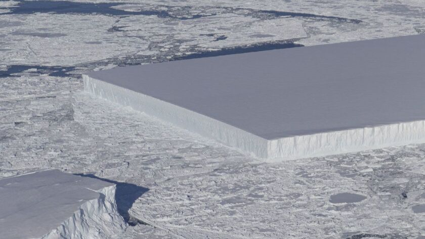 An image from an Operation IceBridge flight over Antarctica shows a tabular iceberg floating among sea ice just off of the Larsen C ice shelf on Oct. 16.