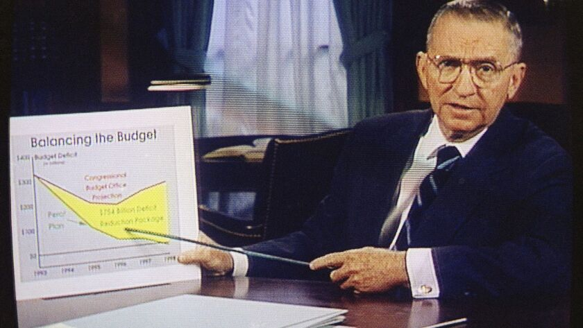 FILE – In this Oct. 16, 1992 file photo Ross Perot is shown on a screen in a paid 30-minute televisi