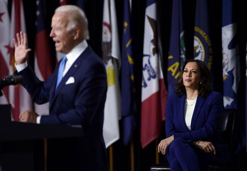 Kamala Harris watches Joe Biden introduce her as his running mate.