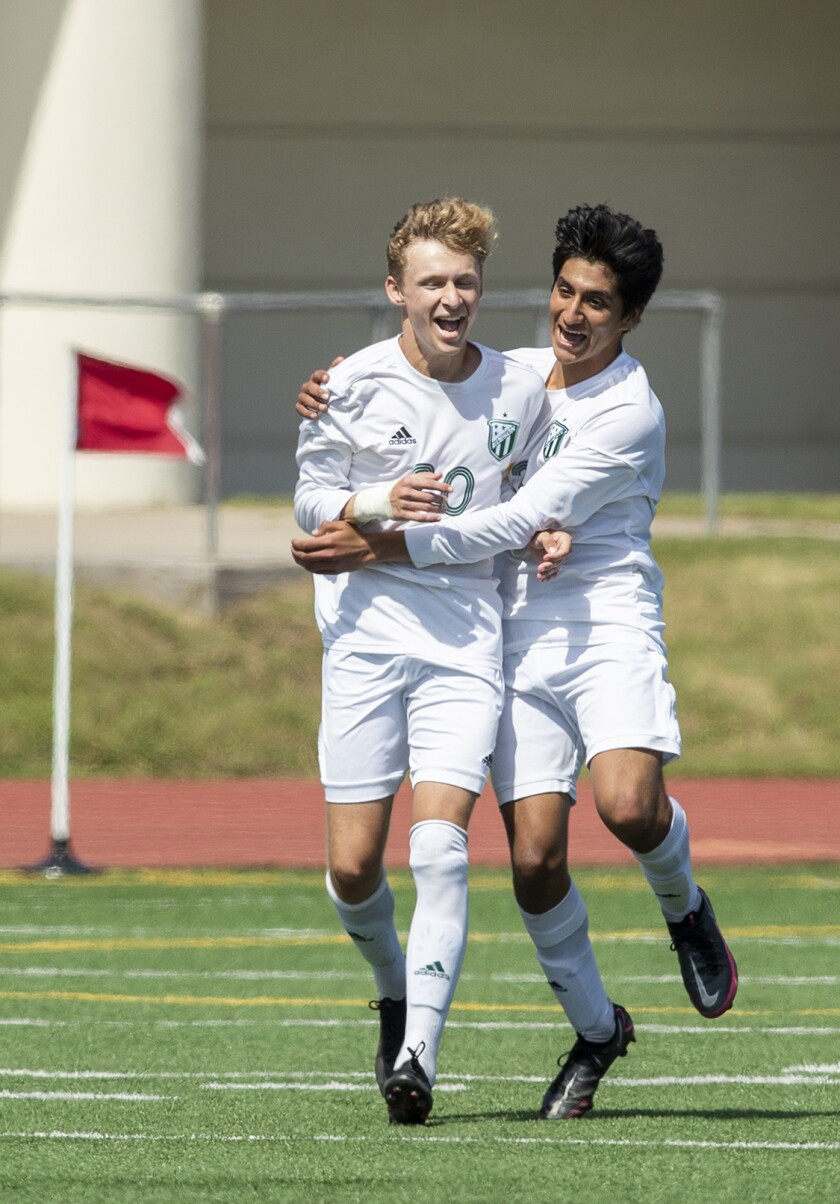 Edison's Kevin Blanco, right, congratulates Trent Bellinger after Bellinger scored a goal against Fountain Valley.