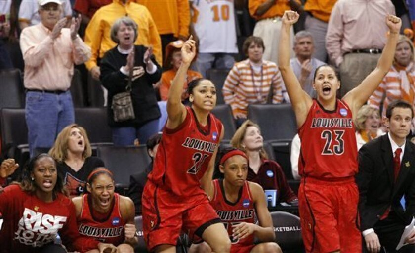 Louisville's bench, including Bria Smith (21) and Shoni Schimmel (23), celebrates the winning free throws against Baylor during the second half of a regional semifinal in the women's NCAA college basketball tournament in Oklahoma City, Sunday, March 31, 2013. Louisville won 82-81. (AP Photo/Alonzo