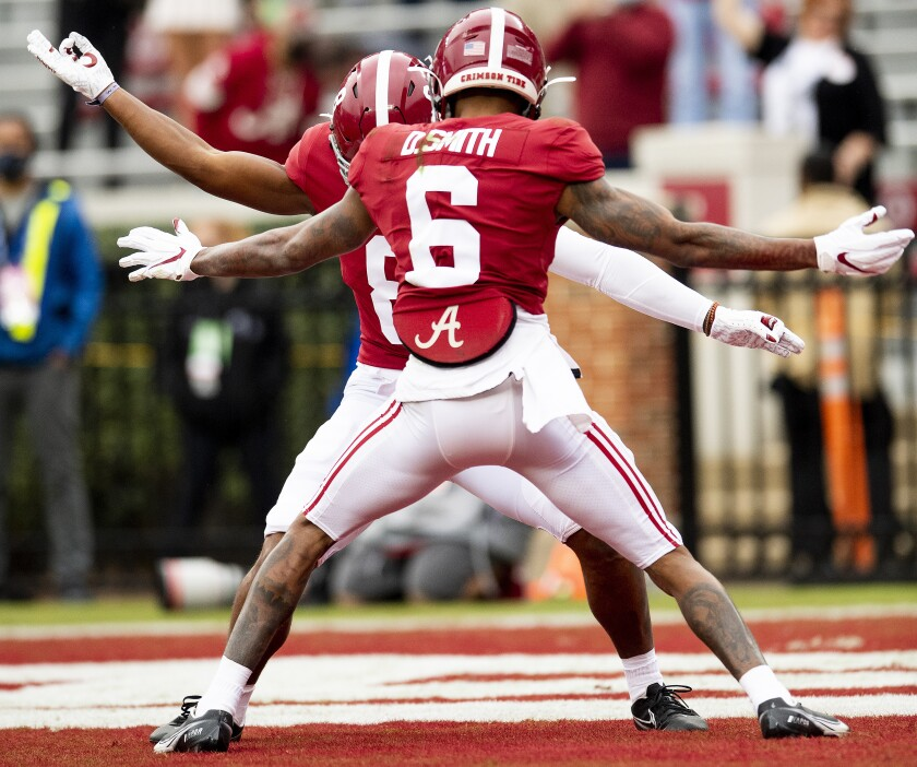 Alabama wide receiver DeVonta Smith (6) and wide receiver John Metchie III (8) celebrate Smith's touchdown against Auburn during an NCAA college football game Saturday, Nov. 28, 2020, in Tuscaloosa, Ala. (Mickey Welsh/The Montgomery Advertiser via AP)