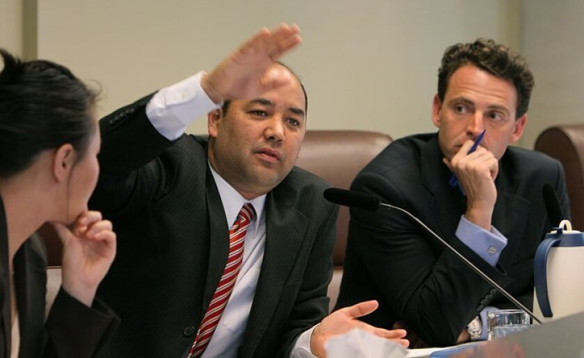 Assemblyman Alberto Torrico, flanked by aide Shirley Kim and Assemblyman Nathan Fletcher, questioned state officials in Poway yesterday.