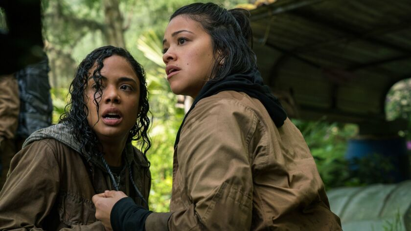 """(L-R) - Tess Thompson and Gina Rodriguez in """"Annihilation"""" from Paramount Pictures and Skydance. Cre"""
