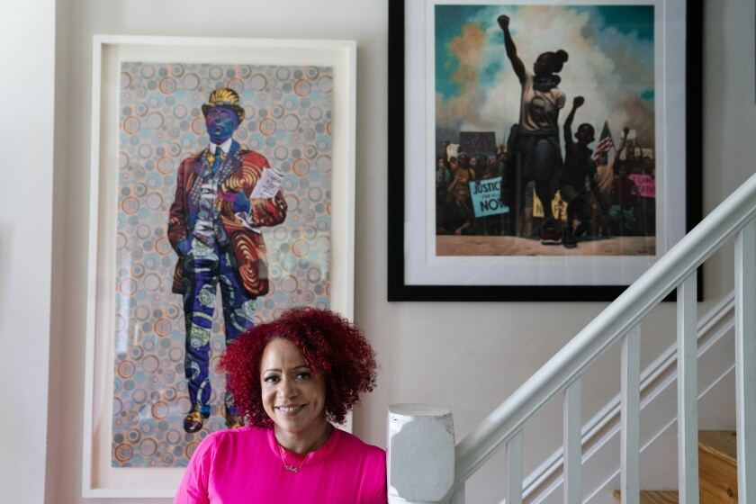 Nikole Hannah-Jones stands for a portrait at her home in the Brooklyn borough of New York
