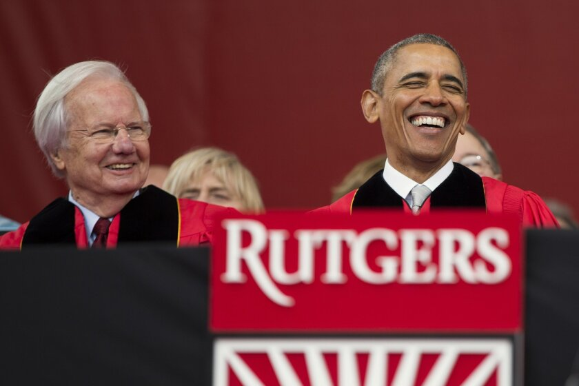 FILE - In this Sunday, May 15, 2016, file photo, President Barack Obama, right, laughs as he sits with longtime PBS journalist Bill Moyers, left, during Rutgers University's 250th anniversary commencement ceremony in Piscataway, N.J. Rutgers University officials say they were told Tuesday, May 24,