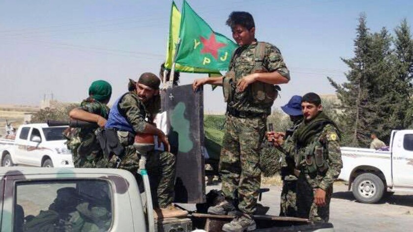 A photo released June 23, 2015, shows Kurdish fighters of the People's Protection Units, or YPG, in the town of Ain Issa, Syria.