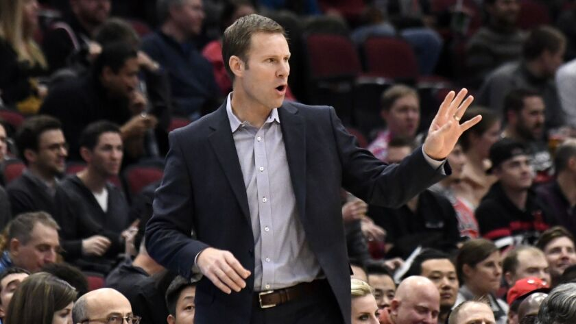 Chicago Bulls head coach Fred Hoiberg gestures to his team during the first half of an NBA basketbal