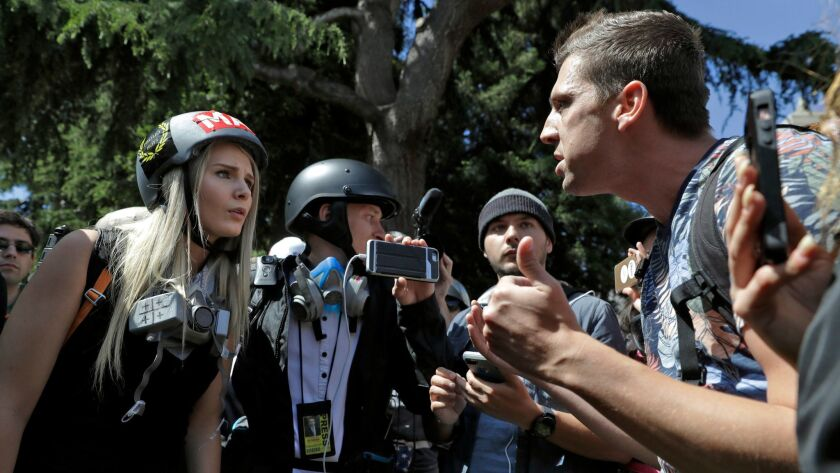 Demonstrators argue during a rally in Berkeley, Calif. to show support for free speech and to condemn the views of Ann Coulter and her supporters on April 27.