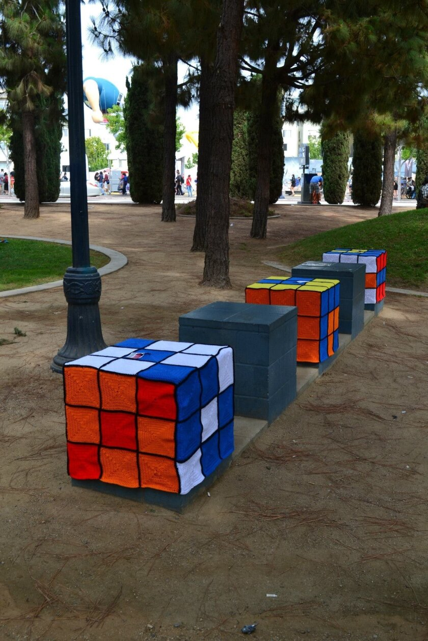 "Concrete ""seats"" decorated as Rubik's Cubes by artists last weekend in Children's Park across from the San Diego Convention Center."