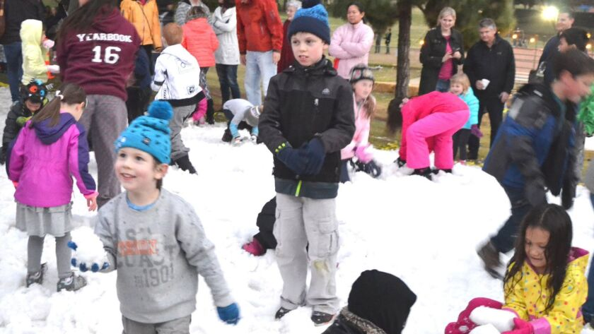 """The inaugural """"Snow in the Park"""" was held in Rancho Bernardo Community Park on Dec. 19. The free eve"""