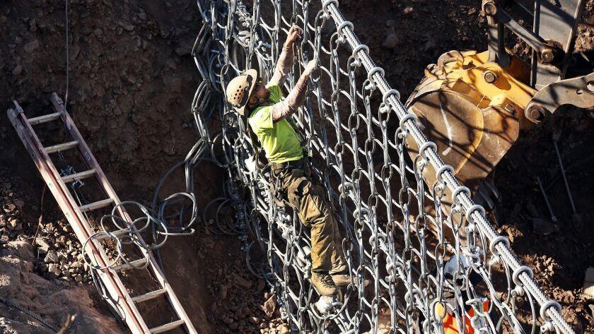 CAMARILLO, CA - DECEMBER 15, 2015 - Jon Simpson, works on installation of one of five debris flow ba