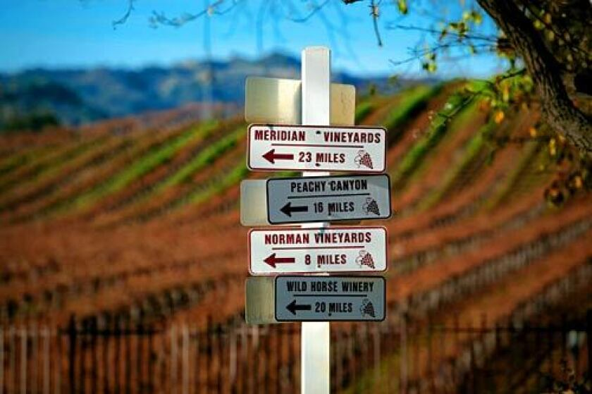 A signpost on the road outside of Justin Vineyards & Winery near Paso Robles guides wine lovers to their next stop.