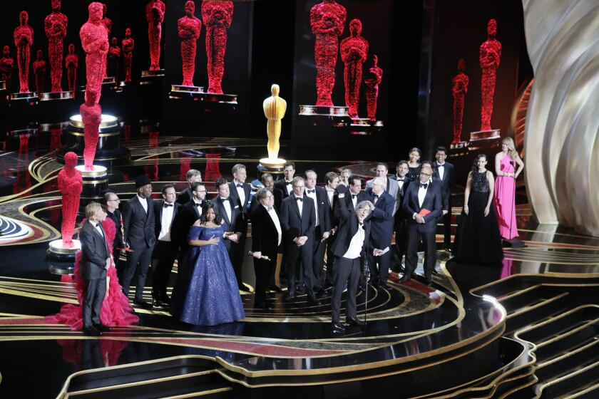 "Director Peter Farrelly, center, and the cast of ""Green Book"" as they win Best Picture during the telecast of the 91st Academy Awards on Sunday."