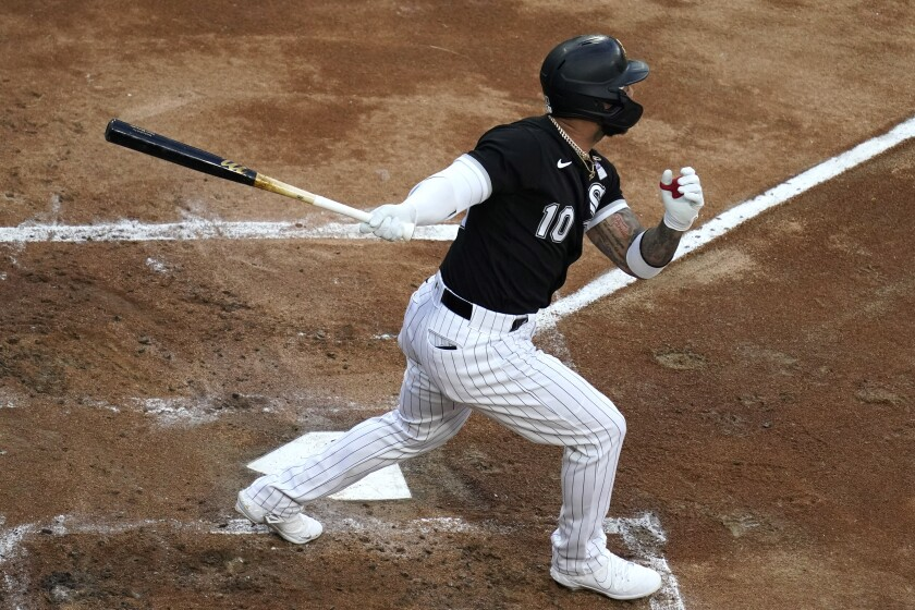 Chicago White Sox's Yoan Moncada watches his solo home run during the first inning of the team's baseball game against the Detroit Tigers in Chicago, Thursday, June 3, 2021. (AP Photo/Nam Y. Huh)