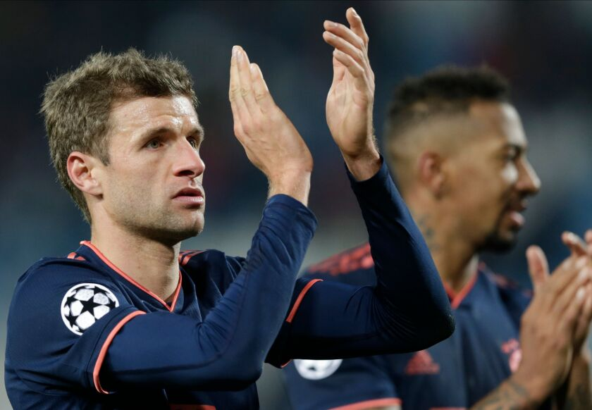 Bayern's Thomas Mueller greets supporters after the UEFA Champions League group B soccer match between Red Star Belgrade and Bayern Munich on Nov. 26 in Belgrade, Serbia.