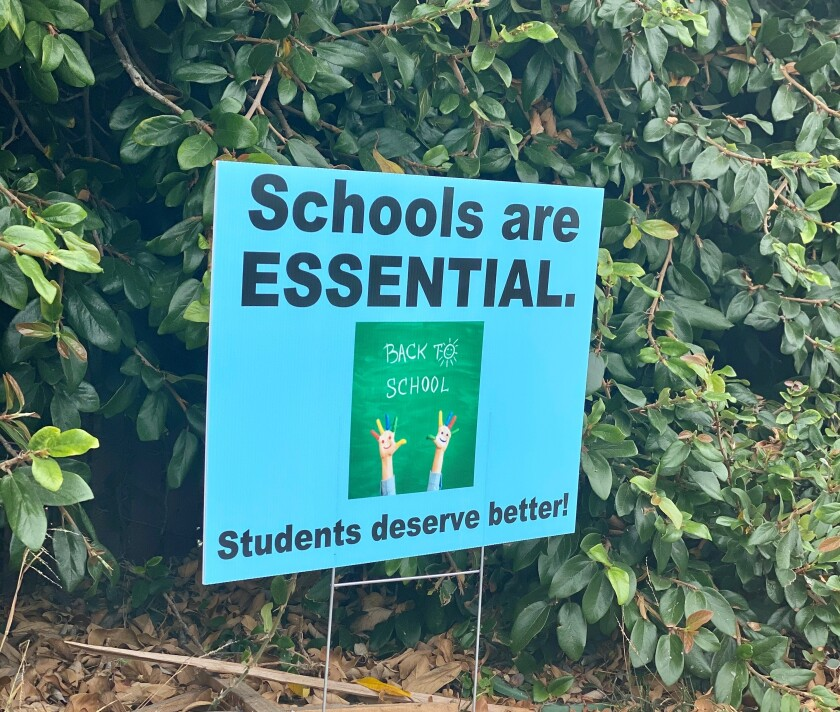 This is one of several signs seen posted Aug. 24 on the perimeter of La Jolla High School.