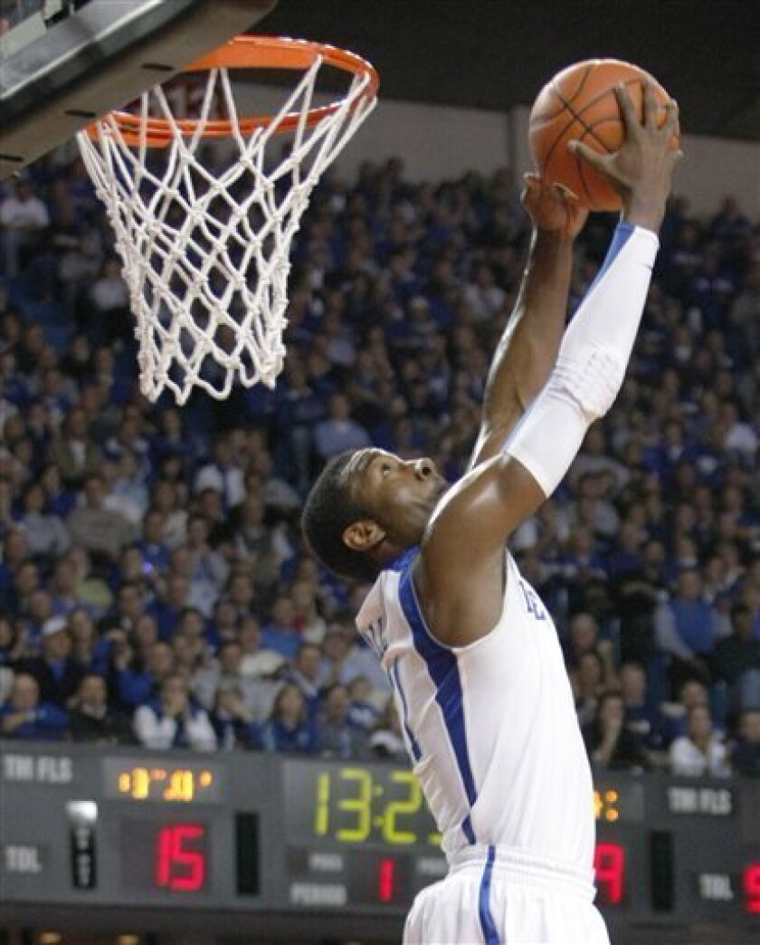 Kentucky's John Wall readies a reverse dunk during the first half of an NCAA college basketball game against North Carolina-Asheville in Louisville, Ky., Monday, Nov. 30, 2009.  (AP Photo/Ed Reinke)