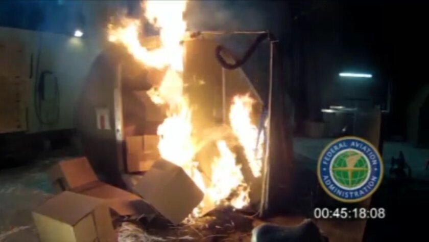 FILE - This file frame grab from video, provided by the Federal Aviation Administration (FAA) shows a test at the FAAs technical center in Atlantic City, N.J. last April, where a cargo container was packed with 5,000 rechargeable lithium-ion batteries. Aircraft manufacturers are urging a ban on bul