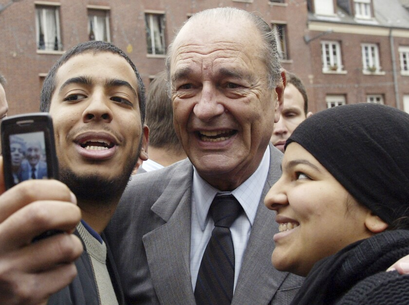FILE - In this Nov.14, 2006 file photo, French President Jacques Chirac poses with residents during his visit to Amiens, northern France. Former French President Jacques Chirac has died at 86. (AP Photo/Michel Spingler, File)