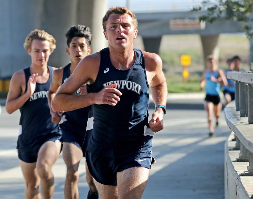 Newport Harbor High School runner Chett Clark wins the boys' varsity cross-country race against Corona del Mar.