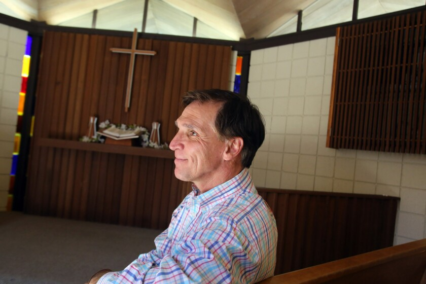 Tyler Wright, the chief executive and president of YMCA of the Foothills, sits in the Samuelson Chapel at the Crescenta-Cañada Y in La Cañada on Tuesday. Wright is leaving his post after nearly 10 years for a similar position in Portland, Ore.