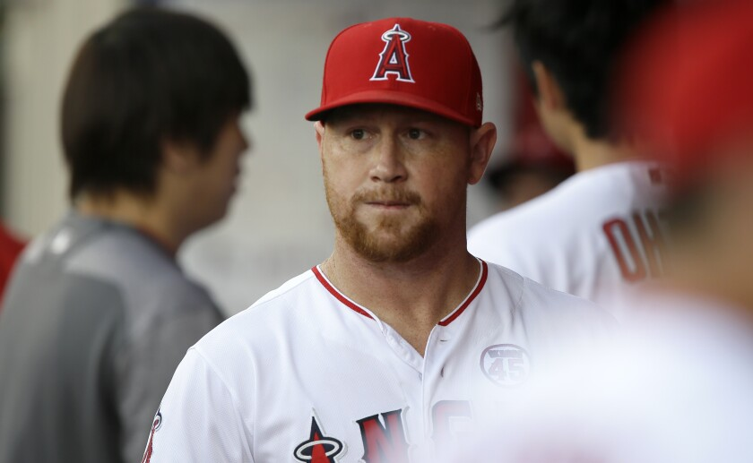 Angels outfielder Kole Calhoun walks through the dugout before a game against the Detroit Tigers on July 30.