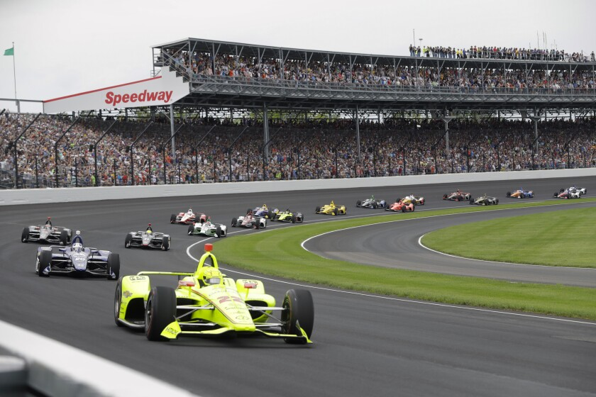 Simon Pagenaud leads the field through the first turn on the start of the 2019 Indianapolis 500.