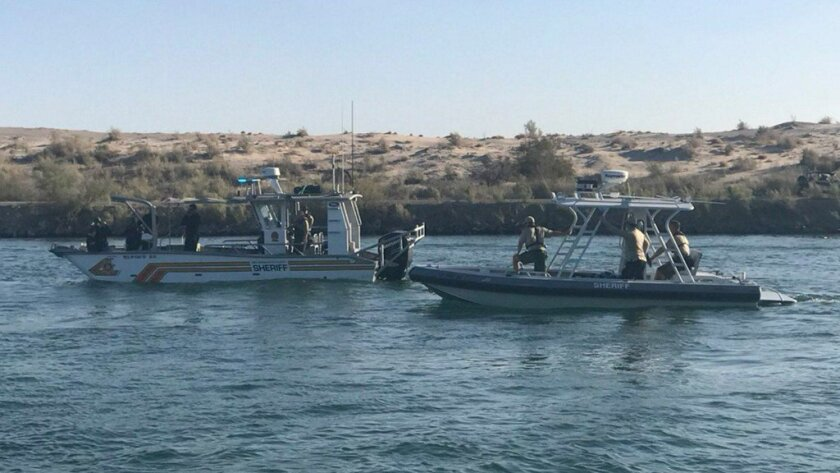 Sheriff's dive teams search for four missing boaters in the Colorado River on Sept. 2, 2018. (Credit
