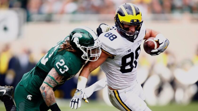 Michigan tight end Jake Butt works against Michigan State's Chris Frey during a game on Oct. 29.