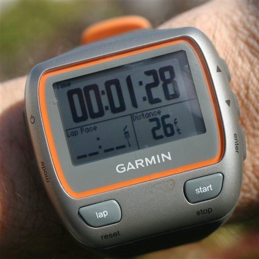 In this photo made Thursday, Oct. 29, 2009, a Garmin Forerunner 310XT is shown in New York. (AP Photo/Mark Lennihan)
