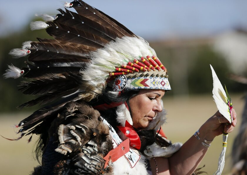 """Wind Walker bows her head in prayer as representatives of several tribes preformed a rain dance on Saturday to attack the drought from a """"spiritual perspective."""""""