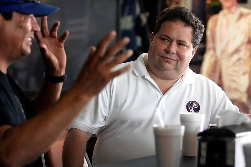 """Rep. Blake Farenthold (R-Texas) talks with a Corpus Christi business owner in August. """"Most of the messages I'm getting from Texas are: 'Hang on, you're doing the right thing,' """" Farenthold said recently of the government shutdown."""