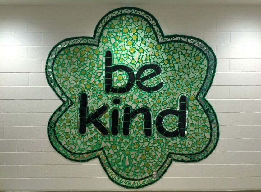 This large mosaic greets students, staff and visitors at the front of the lobby of the new school.