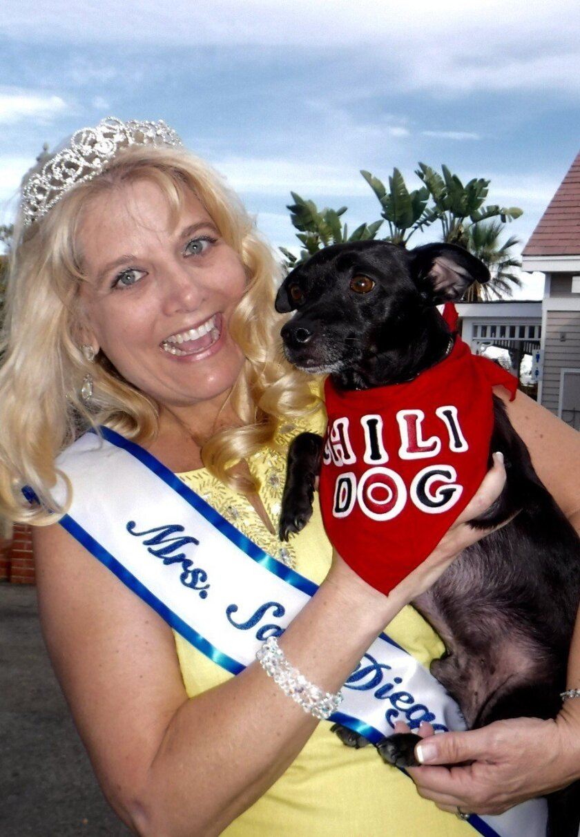 """Mrs. San Diego Carolyn Kirner-Schmidt with a """"chili dog"""" at the Oceanside Heritage Festival."""