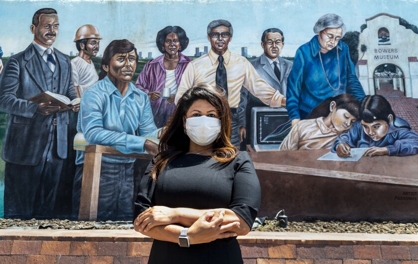 Former Santa Ana city councilwoman Michele Martinez stands in front of a downtown mural.